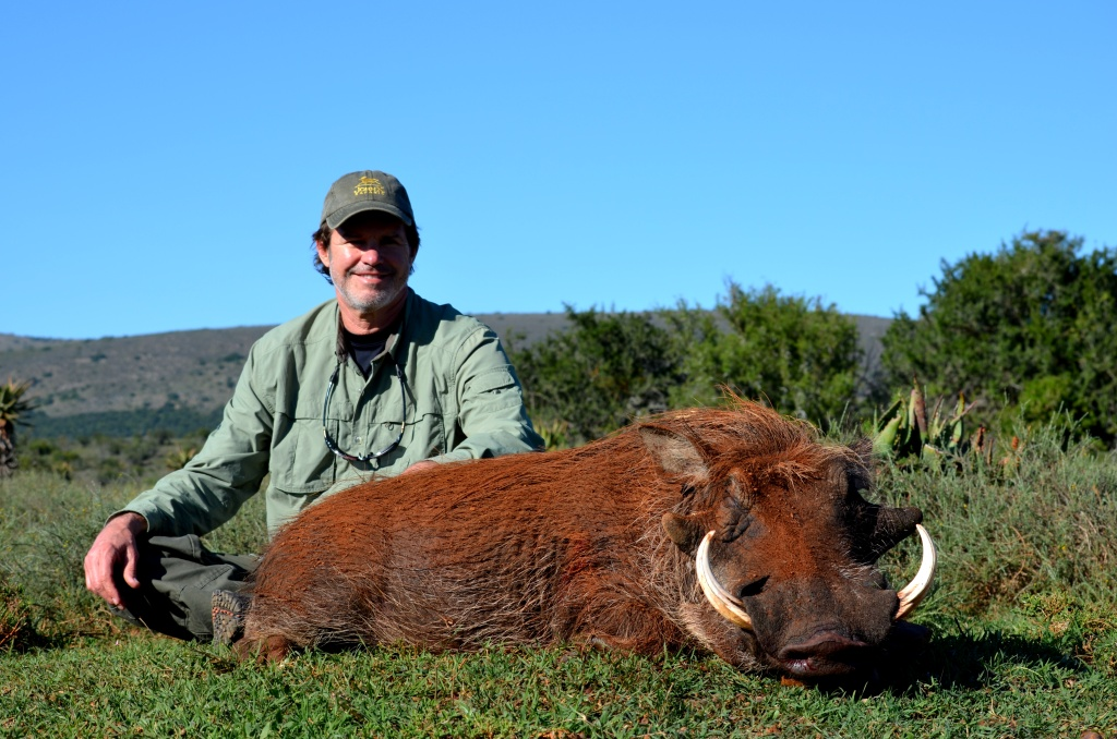 With a steady breeze and decent cover we were able to get within 100 yards of our pig, not a Kudu, let alone the Warthog even knew we were there until the 300 WinMag roared into life.  Randy's African safari was off to a great start!