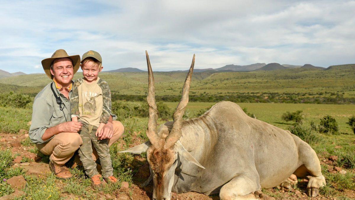 Hunters posing next their kill